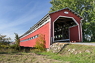 The Prud'homme covered bridge (along Chemin du Pont Prud'homme) crosses the Rivière du Diable (Devils River) near the Village of Brébeuf, Quebec, Canada.  The Prud'homme covered bridge was built in 1918, 100 years before this photograph was made.