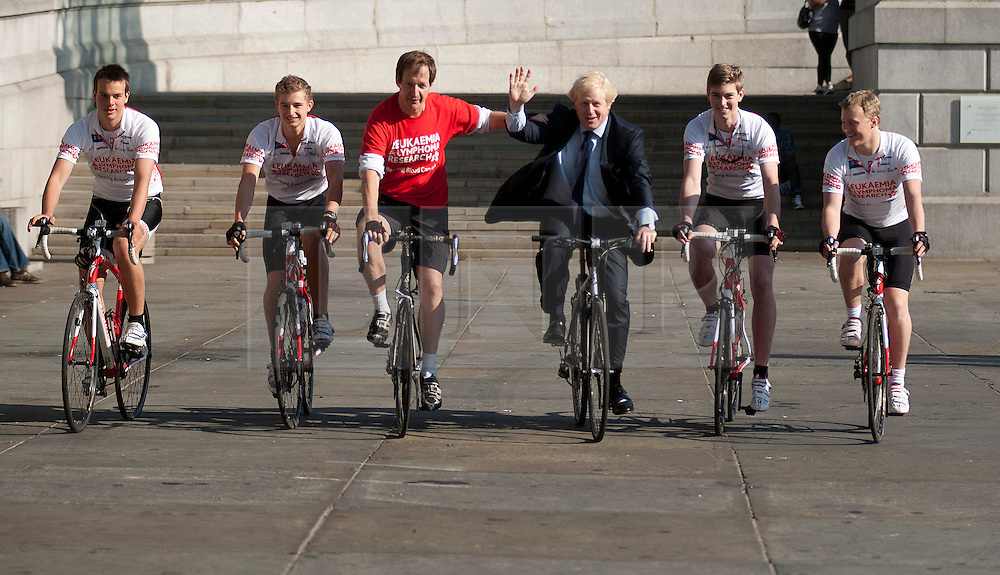 © Licensed to London News Pictures. LONDON, UK  05/07/11. Alastair Campbell, Chairman of Fundraising at Leukaemia and Lymphoma Research, and the Mayor of London, Boris Johnson, ride in Trafalgar Square alongside four school boys who are set to cycle from London to Lisbon in aid of the blood cancer charity. Alastair Campbell, L-R Harry Pearson-Gregory (16), Louise Metcalfe (17), Alastair Campbell, Boris Johnson, Archie Gilmour (17, Boris Johnson's godson) and Tom Prebenson (16), for more information see www.beatbloodcancers.org. Please see special instructions for usage rates. Photo credit should read Matt Cetti-Roberts/LNP