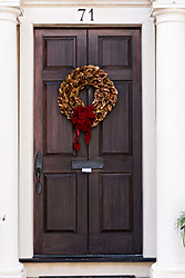 December 21, 2017 - Charleston, South Carolina, United States of America - A Magnolia leaf Christmas wreath hangs from a wooden door on a historic home along King Street in Charleston, SC. (Credit Image: © Richard Ellis via ZUMA Wire)