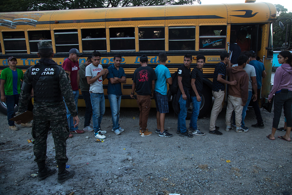 Honduran migrants were taken off a bus on the way to the Guatemalan border, men and women were separated, they were all counted and their effects searched.