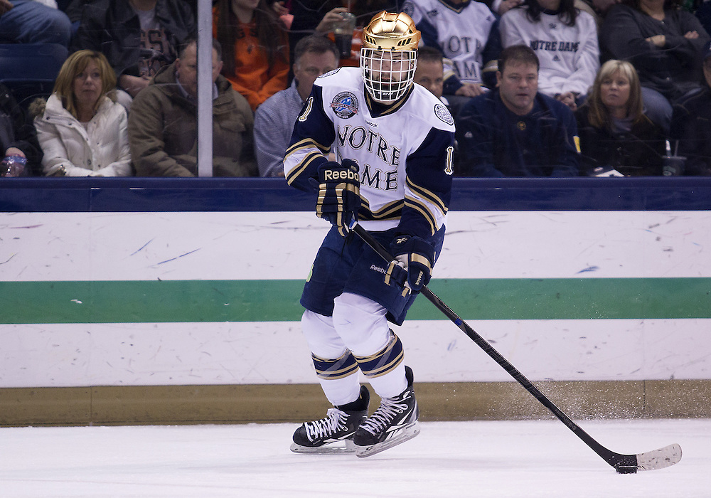 March 15, 2013:  Notre Dame left wing Jeff Costello (11) skates with the puck during NCAA Hockey game action between the Notre Dame Fighting Irish and the Bowling Green Falcons at Compton Family Ice Arena in South Bend, Indiana.  Notre Dame defeated Bowling Green 1-0 in overtime.