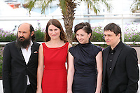 Actor Valeriu Andriuta, Actress Cristina Flutur, actress Cosmina Stratan and Director Cristian Mungiu  at the Dupa Dealuri film photocall at the 65th Cannes Film Festival. Saturday 19th May 2012 in Cannes Film Festival, France.