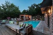 Outdoor space with pool at dusk. Photo by Brandon Alms Photography.