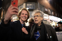© Licensed to London News Pictures. 16/04/2021. London, UK. Brother of former Labour Party Leader Jeremy Corbyn and London mayoral candidate Piers Corbyn takes a selfie with a man in Soho in Central London. Earlier this week Lockdown restrictions were eased to allow non essential retail and outdoor dining to reopen. Photo credit: George Cracknell Wright/LNP