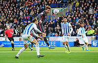 Leeds United's Patrick Bamford vies for possession with Huddersfield Town's Jon Gorenc Stankovic<br /> <br /> Photographer Chris Vaughan - CameraSport<br /> <br /> The EFL Sky Bet Championship - Huddersfield Town v Leeds United - Saturday 7th December 2019 - John Smith's Stadium - Huddersfield<br /> <br /> World Copyright © 2019 CameraSport. All rights reserved. 43 Linden Ave. Countesthorpe. Leicester. England. LE8 5PG - Tel: +44 (0) 116 277 4147 - admin@camerasport.com - www.camerasport.com