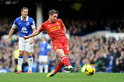 Liverpool's Joe Allen takes a shot at goal. - Photo mandatory by-line: Dougie Allward/JMP - Tel: Mobile: 07966 386802 23/11/2013 - SPORT - Football - Liverpool - Merseyside derby - Goodison Park - Everton v Liverpool - Barclays Premier League