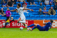 Bournemouth forward Morgan Rogers (27) is tackled by Cardiff City defender Sean Morrison  (4) during the EFL Sky Bet Championship match between Cardiff City and Bournemouth at the Cardiff City Stadium, Cardiff, Wales on 18 September 2021.
