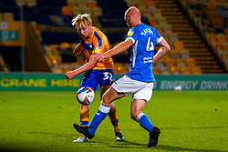 George Lapslie of Mansfield Town gets the ball away from Jason Taylor of Barrow - Mandatory by-line: Ryan Crockett/JMP - 27/10/2020 - FOOTBALL - One Call Stadium - Mansfield, England - Mansfield Town v Barrow - Sky Bet League Two