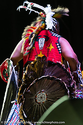 Native American dancer at the Buffalo Chip during the 78th annual Sturgis Motorcycle Rally. Sturgis, SD. USA. Friday August 10, 2018. Photography ©2018 Michael Lichter.