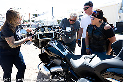 Jacqui Van Ham shows of the new R-1800 at the BMW corporate display downtown Sturgis during the Sturgis Motorcycle Rally. SD, USA. Friday, August 13, 2021. Photography ©2021 Michael Lichter.