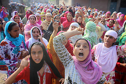 August 4, 2017 - Anantnag, Jammu and Kashmir, India - Kashmiri Muslim women shouted Anti Indian Slogans during funeral procession of a Slain  Hizb rebel Yawar alias Gazi  in Hanfia Eidgah in Janglatandi locality of old town Anantnag, 55 KMs South  of Srinagar. Yawar a 17 day old rebel was killed in an encounter with security forces in Kanelwan village in Dochnipora belt of Bijbehara in the same district on Thursday night. Two other rebels managed to escape from the area while as a civilian- Ghulam Muhamad Bhat from Arwani village of Bijbehara was also killed in the exchange of fire. (Credit Image: © Muneeb Ul Islam/Pacific Press via ZUMA Wire)