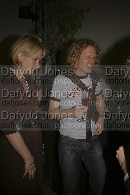 Louisa Buck and Grayson Perry, Undercover Surrealism - private view, Hayward Gallery, South Bank, London,. 9 May 2006. ONE TIME USE ONLY - DO NOT ARCHIVE  © Copyright Photograph by Dafydd Jones 66 Stockwell Park Rd. London SW9 0DA Tel 020 7733 0108 www.dafjones.com