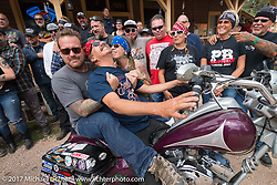Bobby Seeger having fun with Bean're on a stop at the Nemo Guest Ranch on Aidan's Ride to raise money for the Aiden Jack Seeger nonprofit foundation to help raise awareness and find a cure for ALD (Adrenoleukodystrophy) during the annual Sturgis Black Hills Motorcycle Rally. Nemo, SD, USA. Tuesday August 8, 2017. Photography ©2017 Michael Lichter.