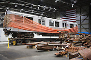 Artifacts chosen by curators out of the wreckage  from the World Trade Center  stored temporarily within an 80,000 square foot hanger at JFK airport, Hanger 17 . Some of the artifacts will be in the National September 11 Memorial Museum set to open in 2012.