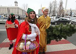December 18, 2018 - Kiev, Ukraine - People wearing costumes of Christmas Elves walk in downtown Kiev, Ukraine, on 18 December 2018. (Credit Image: © Serg Glovny/ZUMA Wire)