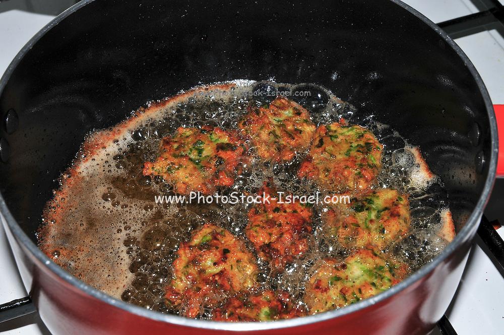 Vegetable patties being deep fried