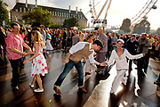 Swing and jive dancers on the glittering outdoor ballroom in the Jubillee Gardens hosted by London's famous Lady Luck and Black Cotton Club during the Thames Festival 08