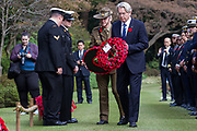The Australian Ambassador to Japan, Richard Court lays a wreath of poppies at the Remembrance Sunday ceremony at the Hodogaya, Commonwealth War Graves Cemetery in Hodogaya, Yokohama, Kanagawa, Japan. Sunday November 11th 2018. The Hodagaya Cemetery holds the remains of more than 1500 servicemen and women, from the Commonwealth but also from Holland and the United States, who died as prisoners of war or during the Allied occupation of Japan. Each year officials from the British and Commonwealth embassies, the British Legion and the British Chamber of Commerce honour the dead at a ceremony in this beautiful cemetery. The year 2018 marks the centenary of the end of the First World War in 1918.