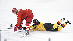 PYEONGCHANG, Feb. 25, 2018  Sergei Andronov (L) of Olympic athletes from Russia vies for the puck during men's ice hockey final against Germany at Gangneung Hockey Centre, in Gangneung, South Korea, Feb. 25, 2018. The Olympic Athletes from Russia team defeated Germany 4:3 and won the gold medal. (Credit Image: © Han Yan/Xinhua via ZUMA Wire)