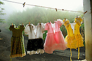 Little girl dresses hang on a laundry line on a porch August 1, 2002 in Utuado, Puerto Rico. Puerto Rico was an outpost of Spanish colonialism for 400 years, until the United States took possession in 1898. Today Puerto Rico's Spanish-speaking culture reflects its history - a mix of African slaves, Spanish settlers, and Taino Indians. Puerto Ricans fight in the U.S. armed forces but are not entitled to vote in presidential elections. They passionately debate their relationship with the U.S. with about half the island wanting to become the 51st state and the other half wanting to remain a U.S. commonwealth. A small percentage feel the island should be an independent country. While locals grapple with the evils of a burgeoning drug trade and unchecked development, drumbeats still drive the rhythms of African-inspired bomba music. (photo by Amy Toensing/Reportage by Getty Images)