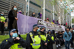 London, UK. 1st May, 2021. Metropolitan Police officers line up outside the Home Office in front of thousands of people attending a Kill The Bill demonstration as part of a National Day of Action to mark International Workers Day. Nationwide protests have been organised against the Police, Crime, Sentencing and Courts Bill 2021, which would grant the police a range of new discretionary powers to shut down protests.
