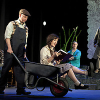 Picture © Drew Farrell. Tel 07721-735041.<br /> <br /> Communicado Theatre Company and the National Theatre of Scotland present <br /> Calum's Road<br /> Adapted by David Harrower, from the book by Roger Hutchinson<br /> Directed by Gerry Mulgrew<br /> <br /> Cast: Angela Hardie, Lewis Howden, Ceit Kearney, Alasdair Macrae, Iain Macrae and Ben Winger<br /> <br /> Touring to: Ayr, Greenock, Dumfries, Perth, Musselburgh, Arbroath, Edinburgh, Kirkcaldy, Stranraer, Inverness, Ullapool, Isle of Skye and Stirling.<br /> <br /> <br /> Calum's Road has become the stuff of modern folklore. It is the remarkable true story of one man's single-minded determination to challenge the powers-that-be. <br /> Calum MacLeod, having battled the inaction of authorities on Raasay for years, sets off alone with a pick, a shovel and a wheelbarrow to build a road that will connect up the island. <br /> His daughter has been forced to board at secondary school on Skye and now Calum's not having it any more. <br /> He wants to turn the tide of neglect and indifference and keep his family - and community - together. <br /> His unpaid labour of love was to dominate the last 10 years of Calum's life and leave behind a legacy – both practical and poetic - carved into the landscape he loved. <br /> Based on Roger Hutchinson''s book of the same name, playwright David Harrower offers audiences the richly detailed and unhurried description of a dying way of life in Northern Raasay.<br /> <br /> Creative team:  Gordon Davidson (Design), Sergey Jakovsky Lighting Design.  Alasdair Macrae (Music), Malcolm Shields (Assistant Direction Movement) John McGeoch (Video Design).  <br /> <br /> Cast <br /> Calum - Iain Macrae<br /> Julia/Lexie - Ceit Kearney<br /> Young Julia - Angela Hardie<br /> Alex/Young Iain - Ben Winger<br /> Iain - Lewis Howden<br /> Performer/Musical Director - Alasdair Macrae (playing offstage most of the time)<br /> <br /> <br /> Press contacts:<br /> Liz Smith – Publicist, The Strange