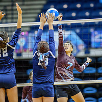 Window Rock Scouts Jana Solee (22), left, and Sonja Ayze  (13) challenge Ganado Hornet XXX (7) above the net at the Fighting Scout Event Center in Fort Defiance Tuesday.