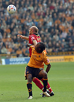 Photo: Kevin Poolman.<br />Wolverhampton Wanderers v Colchester United. Coca Cola Championship. 14/10/2006. Colchester's Wayne Brown and Rohan Ricketts fight over the ball.