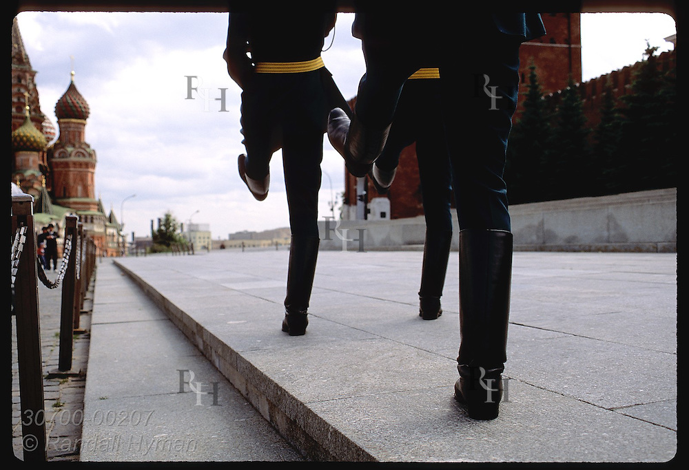 Goose-stepping boots of Lenin's Tomb guards march past Kremlin wall on Red Square in Moscow. Russia