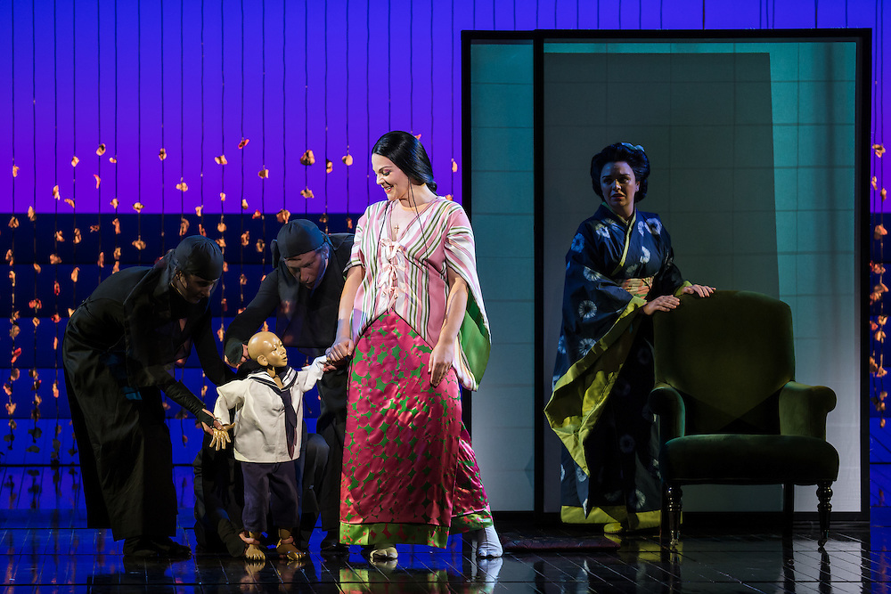 """LONDON, UK, 14 May, 2016. Rina Harms (centre, as Butterfly) and Stephanie Windsor-Lewis (right, as Suzuki) rehearse with members of the cast for the revival of director Anthony Minghella's production of Puccini's opera """"Madam Butterfly"""" at the London Coliseum for the English National Opera. The production opens on 16 May. Photo credit: Scott Rylander."""