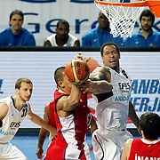 Efes Pilsen's Lawrence ROBERTS (R) and Sinan GULER (L) during their Turkish Basketball league match Efes Pilsen between Tofas at the Sinan Erdem Arena in Istanbul Turkey on Sunday 27 February 2011. Photo by TURKPIX