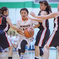 Wingate Bear Dellena Payton (10) pushes past Grants JV Pirates Alyssa Anzures (30) and Mikayla Montoya (3) Friday at Wingate High School.