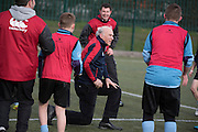 © Licensed to London News Pictures. 02/02/2015. Twickenham, UK. VINCE CABLE TAKES A TUMBLE - he was unhurt and laughed it off with the children present.  The British Deputy Prime Minister, Nick Clegg and the Secretary of State for Business, Innovation and Skills, Vince Cable take part in the All Schools training session at Twickenham Academy, Today 2nd February 2015.<br /> <br /> Deputy Prime Minister Nick Clegg, and the Secretary of State for Business, Innovation and Skills, Vince Cable, visit Twickenham on Monday 2 February in support of the biggest year in history for English rugby . The visit comes just days before England's first Six Nations clash against Wales and ahead of the World Cup, which will support 12,000 jobs and contribute £2.2 billion to the UK economy, as well as creating a lasting legacy for rugby in this country.. Photo credit : Stephen Simpson/LNP
