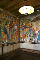 Beach Chalet WPA Murals - The Beach Chalet opened to the public in 1925. At that time, it had a lounge and changing rooms on the first floor and a restaurant on the second that provided diners with a beautiful view of the Pacific Ocean.  The ground floor is surrounded by the intricate wood carvings, created by Michael Von Meyeran, and an interpretive exhibit of the fresco murals, by Lucien Labaudt. The murals depict some depression-era scenes of San Francisco which have become synonymous with San Francisco: The Embarcadrero, Fisherman's Wharf, Baker Beach, Golden Gate Park, Land's End, the Marina and Chinatown. The woodcarvings consist of an intricate balustrade with octopus newel posts, a sea monster, mermaids, divers and old ships.
