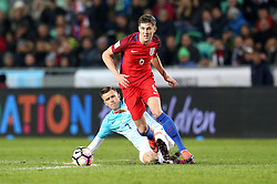 John Stones of England goes past the tackle from Josip Illicic of Slovenia - Mandatory by-line: Robbie Stephenson/JMP - 11/10/2016 - FOOTBALL - RSC Stozice - Ljubljana, England - Slovenia v England - World Cup European Qualifier