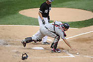CHICAGO - JULY 09:  Joe Mauer #7 of the Minnesota Twins makes a play on a ball hit by Gordon Beckham #15 of the Chicago White Sox on July 9, 2011 at U.S. Cellular Field in Chicago, Illinois.  The White Sox defeated the Twins 4-3.  (Photo by Ron Vesely)  Subject: Joe Mauer;Gordon Beckham