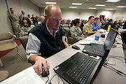 WHNPA member Preston Keres mans the social media network as he provides real time feedback to military photographers worldwide during the Military Photographer of the Year judging at Defense Information School, Fort Meade, Maryland.  Photo by Johnny Bivera