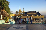 Myanmar, Mon State, Kyaiktiyo Pagoda (Golden Rock Pagoda) pilgrims climb the steep path