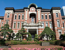 Exterior facade of historic Tokyo Station red brick building in Tokyo Japan