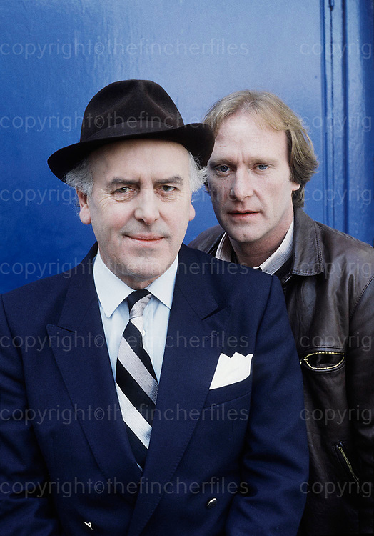British actors George Cole and Dennis Waterman seen on the set of the TV series 'Minder' in London in 1984. Photograph by Terry Fincher