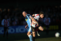 Tommy Mooney left for Wycombe, Brian Wilson right for Cheltenham<br /> <br /> Photo: Richard Eaton.<br /> <br /> Cheltenham Town v Wycombe Wanderers. Coca Cola League 2. 04/03/2006.