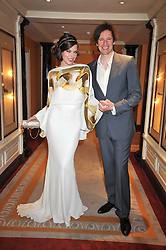 MILLA JOVAVICH and husband PAUL ANDERSON at the 3rd Fortune Forum Summit held at The Dorchester Hotel, Park Lane, London on 3rd March 2009.