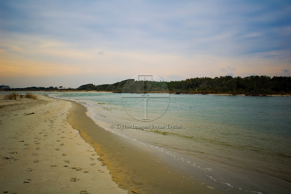 Footprints along the creek that feeds into the ocean in Pawleys Island, South Carolina.