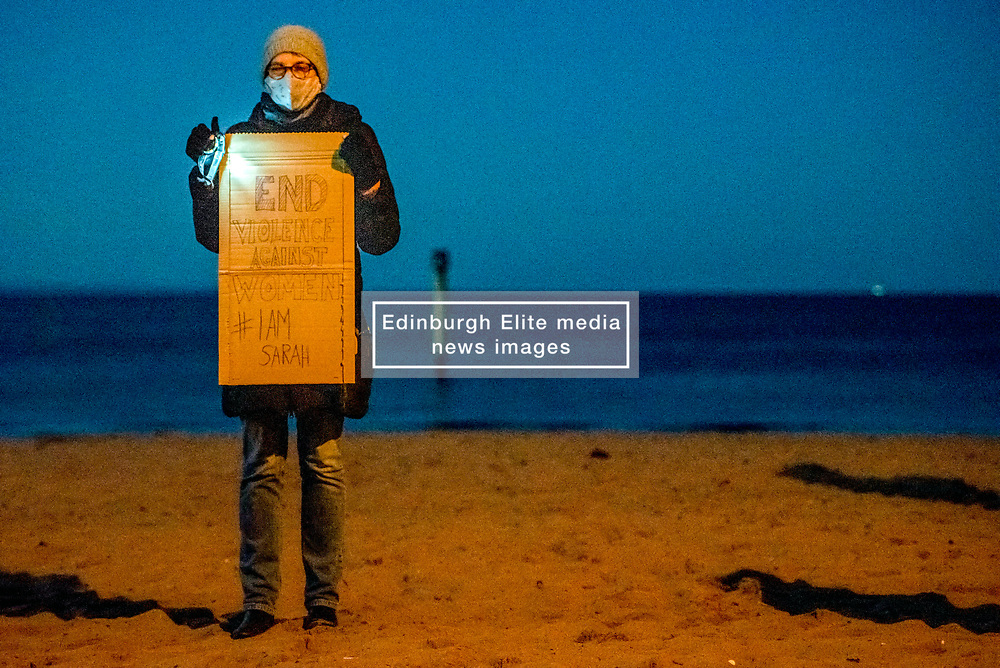 Pictured: A socially distanced vigil in support of the campaign to end violence against women was held tonight on Portobello beach, Edinburgh<br /> <br /> <br /> © Jon Davey/ EEm