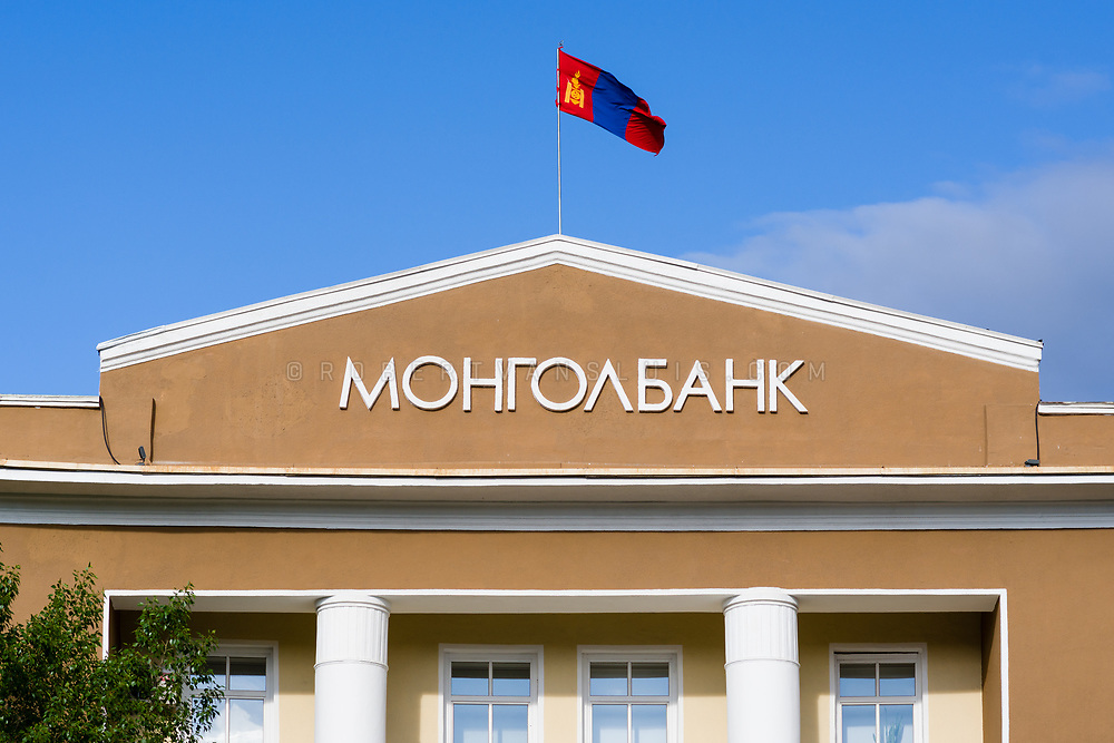 The Mongolian flag flies on top of the Mongolbank building in Ulaanbaatar, Mongolia. Photo © robertvansluis.com
