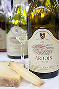 bottle with moulded relief on neck glass of arbois savagnin comte cheese domaine de la pinte arbois france