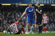 Branislav Ivanovic of Chelsea helping up Sadio Mane of Southampton. Barclays Premier league match, Chelsea v Southampton at Stamford Bridge in London on Sunday 15th March 2015.<br /> pic by John Patrick Fletcher, Andrew Orchard sports photography.