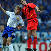 l-r;  Japan's Takayuki Suzuki jumps Belgium's Jacky Peters