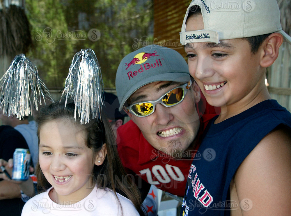 """Jul 01, 2003; Anaheim, California, USA; Moto X star athlete MIKE METZGER poses for a picture with fans at the opening of Disney's California Adventure """"X Games Experience"""".  Disney park has built two X-Arena's specifically for this 41 day event highlighting extreme sports for the launch of the 2003 ESPN X Games.<br />Mandatory Credit: Photo by Shelly Castellano/Icon SMI<br />(©) Copyright 2003 by Shelly Castellano"""