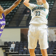 UNCW's Sarah Myatt shoots against Western Carolina's Briane Mack Saturday November 29, 2014 at Trask Coliseum in Wilmington, N.C. (Jason A. Frizzelle)